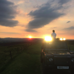 land rover with sunset